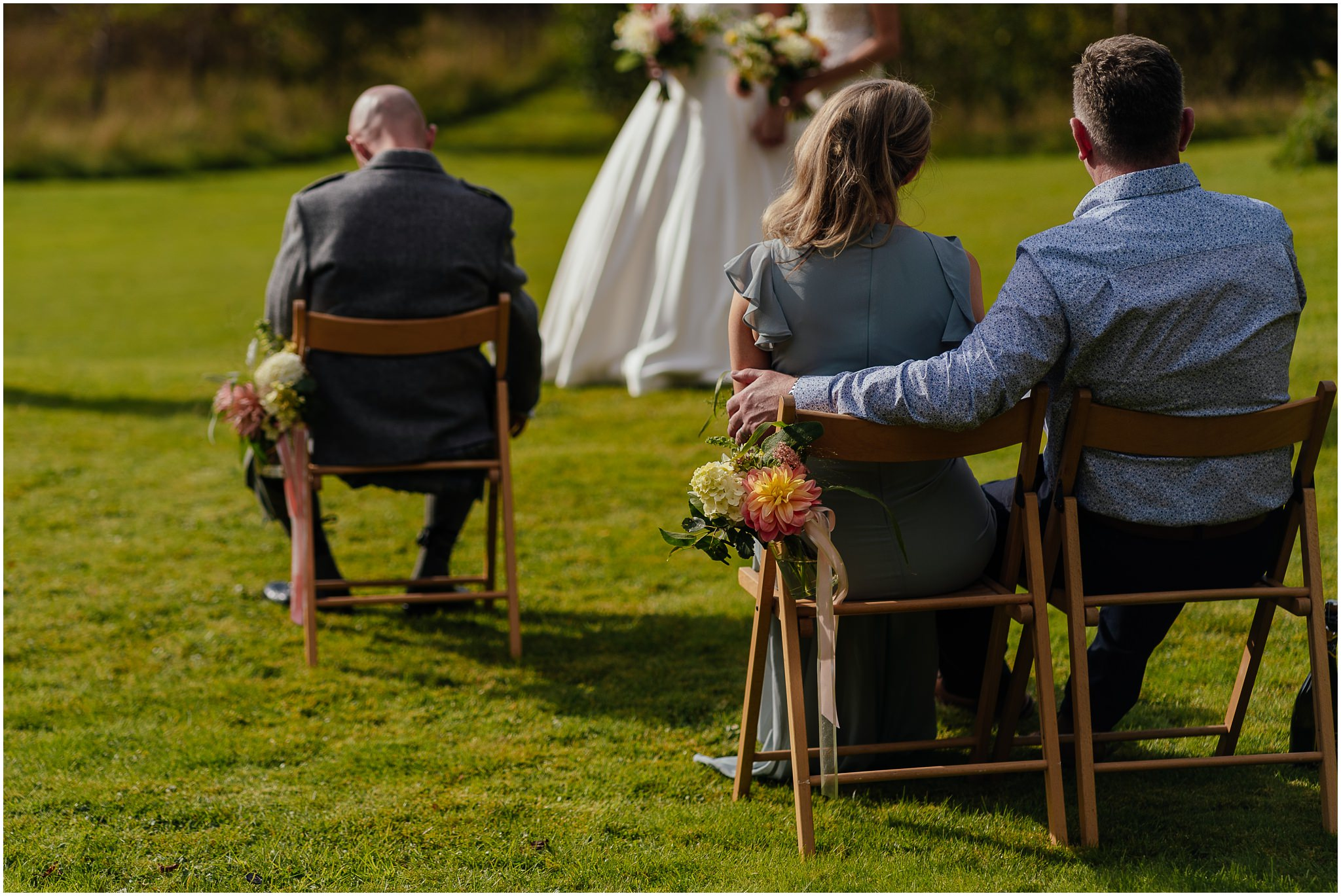 micro wedding ceremony scotland flowers in jars hanging off chairs outdoor ceremony