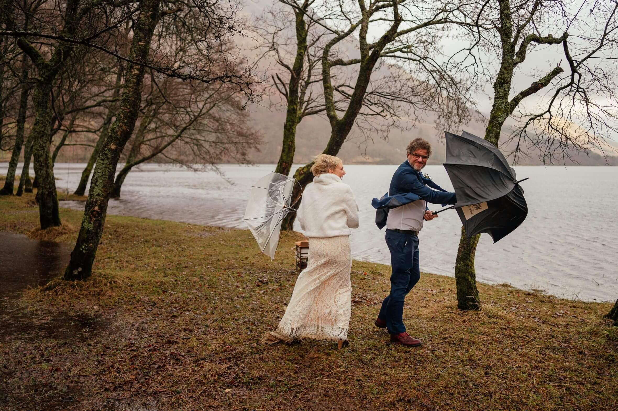monachyle mhor elopement rain wedding bride groom at loch voil windy umbrellas