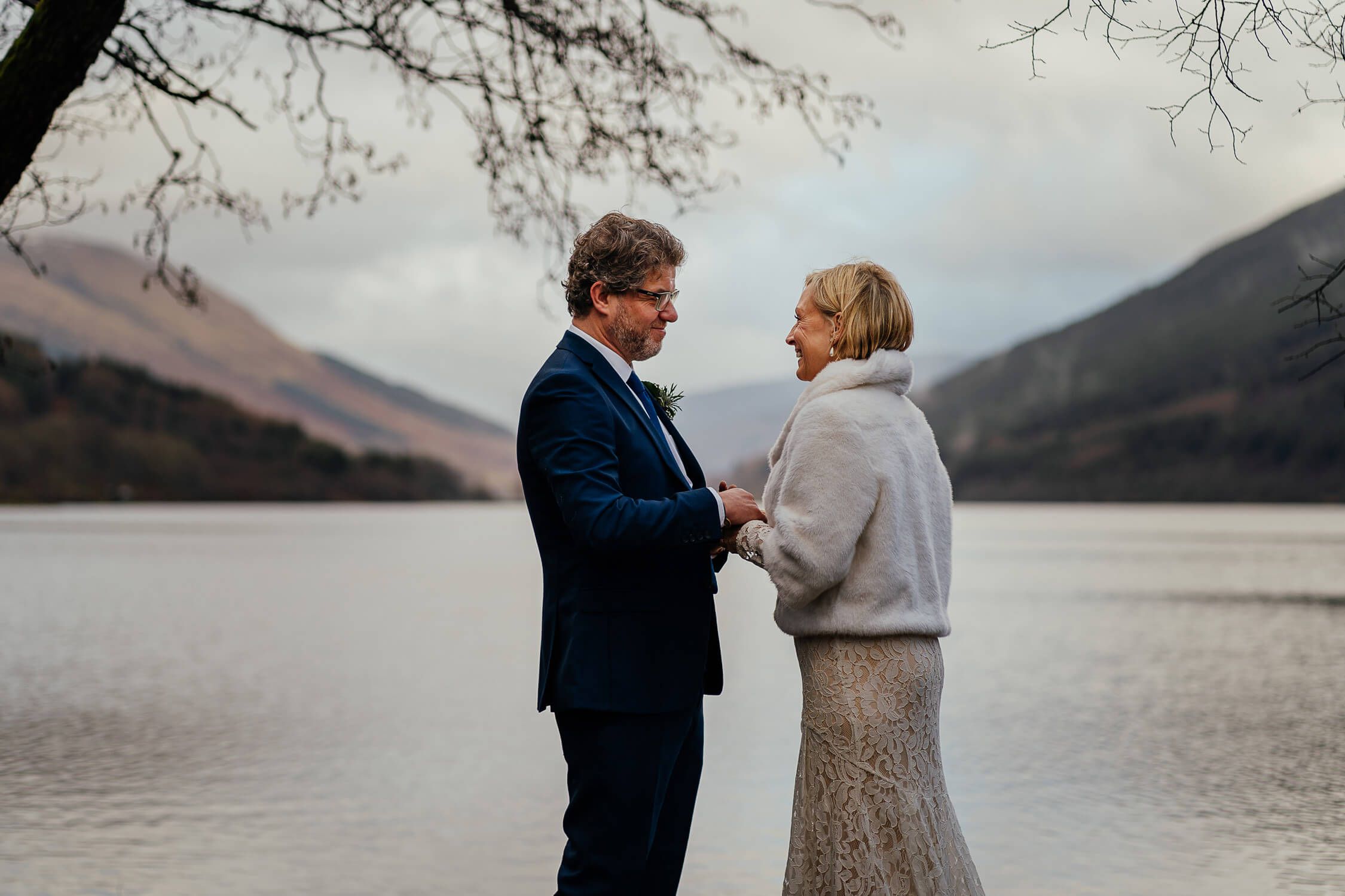 bride groom secret elopement to monachyle mhor exchanging vows rings on banks of loch voil - Scotland elopement